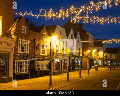 Oldest Chemist Shop in England in the Market Place at dusk Knaresborough North Yorkshire England - Stock Photo