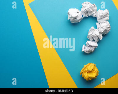 Question mark made with crumpled paper balls on a colorful background with space for text - Stock Photo
