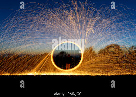 Steel wool photography. Light trails created by sparks during a long exposure photograph of burning steel wool. - Stock Photo