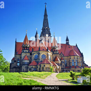 Image of Saint Martin church in Neustadt, Dresden, Germany. Amazing architecture with high towers and red roof. Cloudless spring morning. View of the  - Stock Photo