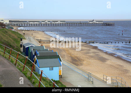 beach huts and pier  on southwold beach on the suffolk coast england - Stock Photo