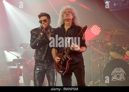 Singer Adam Lambert and guitarist Brian May of the rock band Queen are shown performing on stage during a 'live' concert appearance. - Stock Photo