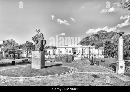 CAPE TOWN, SOUTH AFRICA, AUGUST 17, 2018: The South African National Gallery, with a statue of General Jan Smuts in front, at the Company Gardens in C - Stock Photo
