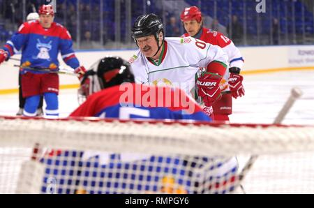 Sochi, Russia. 15th Feb, 2019. Belarus President Alexander Lukashenko, center, takes a shot on goal during a friendly ice hockey match with Russian President Vladimir Putin, #11, at the Shaiba Arena February 15, 2019 in Sochi, Russia. Credit: Planetpix/Alamy Live News - Stock Photo