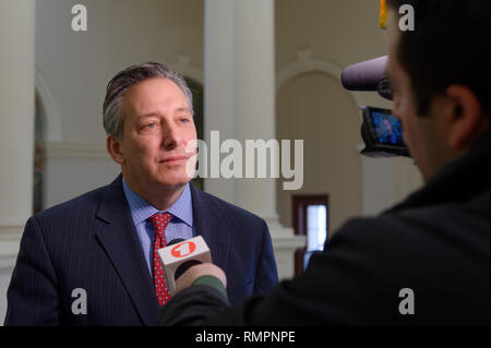 Mineola, New York, USA. 15th Feb, 2019. JON KAIMAN, Deputy County Executive in Suffolk, is interviewed by Verizon FIOS 1 news reporter after Kaiman spoke at NYS Senate Public Hearing on Climate, Community & Protection Act, Bill S7253, sponsored by Sen. Kaminsky, Chair of Senate Standing Committee on Environmental Conservation. This 3rd public hearing on bill to fight climate change was on Long Island. Credit: Ann Parry/ZUMA Wire/Alamy Live News - Stock Photo