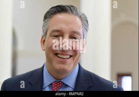 Mineola, New York, USA. 15th Feb, 2019. JON KAIMAN, Deputy County Executive in Suffolk, is in round atrium of Nassau County Executive Building after he spoke at NYS Senate Public Hearing on Climate, Community & Protection Act, Bill S7253, sponsored by Sen. Kaminsky, Chair of Senate Standing Committee on Environmental Conservation. This 3rd public hearing on bill to fight climate change was on Long Island. Credit: Ann Parry/ZUMA Wire/Alamy Live News - Stock Photo