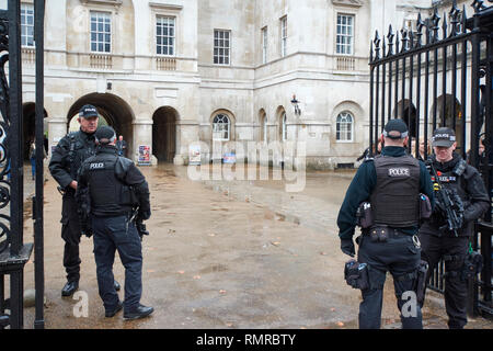 LONDON WHITEHALL ARMED POLICE ON DUTY AT HORSE GUARDS - Stock Photo