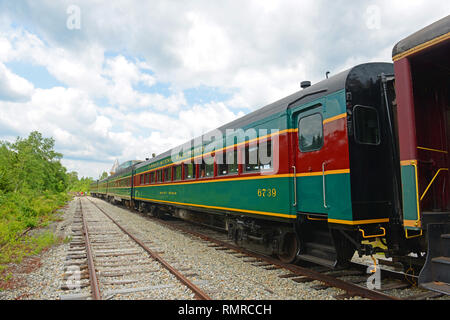 Conway Scenic Railroad passenger train in Crawford Notch Station in White Mountains, New Hampshire, USA. - Stock Photo