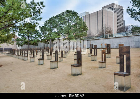 Oklahoma City, Oklahoma, United States of America - January 18, 2017. Oklahoma City National Memorial in Oklahoma City, OK, with empty chair sculpture - Stock Photo