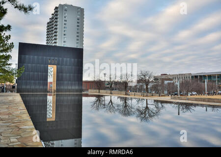 Oklahoma City, Oklahoma, United States of America - January 18, 2017. Reflecting Pool and the Gates of Time of the Oklahoma City National Memorial in  - Stock Photo