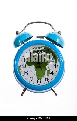 Alarm clock and world map with africa. Composite image depicting doomsday clock. - Stock Photo