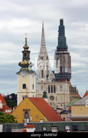 ZAGREB, CROATIA – JUNE 12, 2013: a view over the roofs of  the Zagreb Cathedral towers - Stock Photo