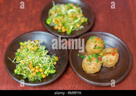 Vegetarian food. Buckwheat Salad and Cutlets. buckwheat burgers. healthy food on a brown background. - Stock Photo