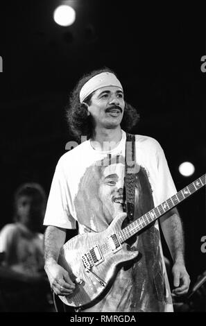 Singer, songwriter and guitarist Carlos Santana is shown performing on stage during a concert appearance. - Stock Photo
