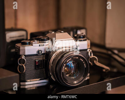 antique shop sold the old slr camera with lens - Stock Photo