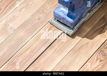 Wooden floor and blue grinder - Stock Photo