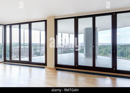 Modern white empty loft apartment interior with parquet floor and panoramic windows, Overlooking the metropolis city - Stock Photo