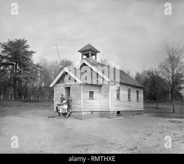 Teacher with Young Students Standing on Steps of One-Room Schoolhouse, South River Farm, Maryland, USA, National Photo Company, 1924 - Stock Photo