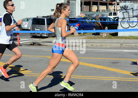 Male and Female Runners In the New York City Marathon On 44th Drive at 10th Street In Long Island City, Queens, New York, USA - November 4th, 2018 - Stock Photo