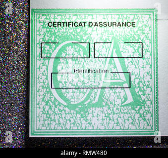 Paris, France - Feb 3, 2018: French International Motor Insurance Card System know as Certificat d'assurance seen on the glitter background  - Stock Photo