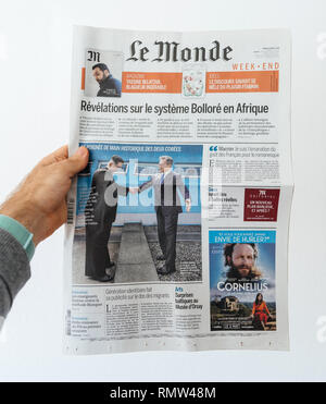 Paris, France - Apr 28, 2018: North and South Korean leaders shake hands at the border cover on Le Monde French newspaper - white background - Stock Photo