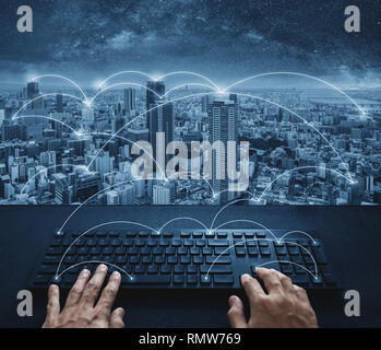 Internet networking and connection, Hand typing digital keyboard and cityscape - Stock Photo