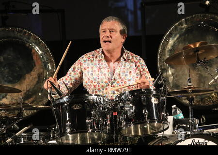 Drummer Carl Palmer is shown performing on stage during his tribute concert to keyboardist Keith Emerson. - Stock Photo