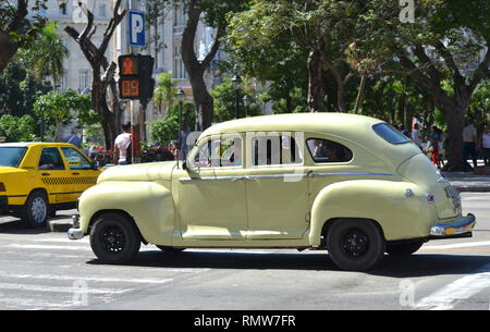 Havana Cuba - old vintage retro cars from the 50`s in the streets of Havana as taxi and their drivers - Stock Photo