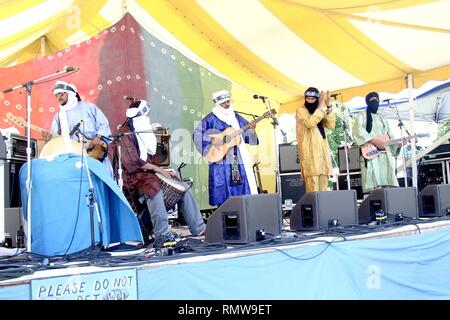 Tinariwen,  a band of Tuareg-Berber musicians from the Sahara Desert region of northern Mali, are shown performing on stage during a 'live' concert appearance. - Stock Photo
