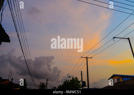 A Lagos Twilight with Electricity Poles and Wires - Stock Photo