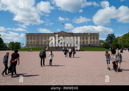 People visiting the Royal Palace in Oslo, Norway on a clear, spring day. - Stock Photo