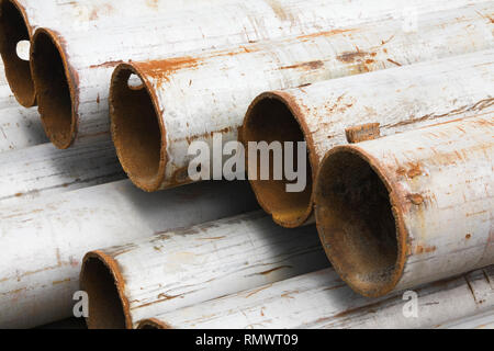 Close-up of rusted steel pipes with coat of primer paint - Stock Photo