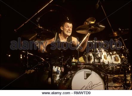 Emerson, Lake & Palmer drummer Carl Palmer is shown performing on stage during a 'live' concert performance. - Stock Photo