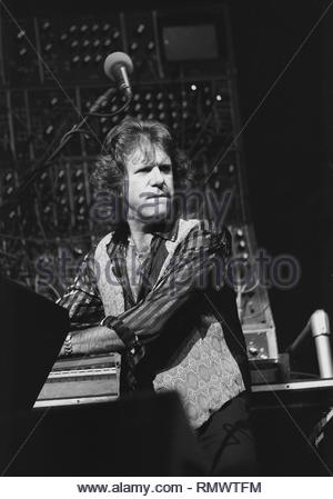 Emerson, Lake & Palmer keyboardist Keith Emerson is shown performing on stage during a 'live' concert appearance. - Stock Photo