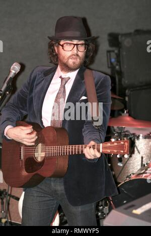Singer, songwriter, musician and actor Sean Ono Lennon is shown performing on stage during a 'live' concert appearance. - Stock Photo
