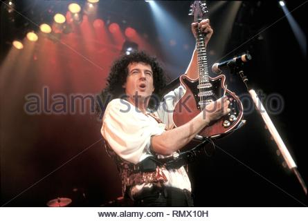 Astrophysicist and musician Brian May, most widely known as the lead guitarist of the rock band Queen, is shown performing on stage during a concert with his solo band. - Stock Photo