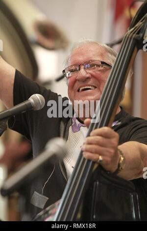Rock N' Roll Hall of Fame musician Marshall Lytle is shown playing his stand up bass guitar during a 'live' concert performance. - Stock Photo
