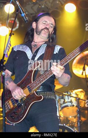 Bassist, singer and songwriter Lemmy Kilmister of the hard rock band Motörhead is shown performing on stage during a 'live' concert appearance. - Stock Photo