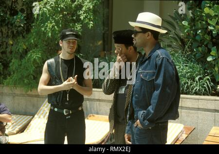 Donnie Wahlberg of New Kids on the Block is shown talking with Run DMC at the Rio Palace Hotel during Rock in Rio II. - Stock Photo