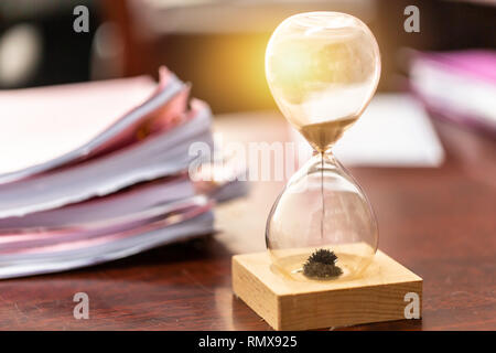 Business working jobs remaining with hourglass for time work concept. - Stock Photo