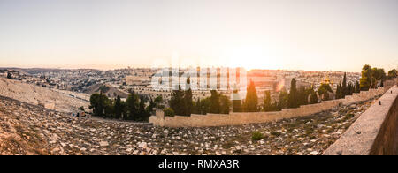 Old muslim cemetery at sunset on olive mountain in old Jerusalem, Israel - Stock Photo