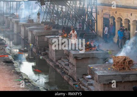 PASHUPATINATH, KATHMANDU, NEPAL-CIRCA 2013 : Hindu cremation process in progress at a temple in Pashupatinath, Nepal. - Stock Photo