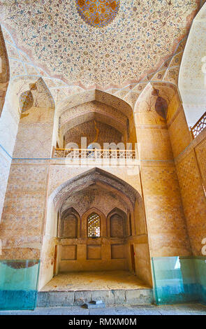 ISFAHAN, IRAN - OCTOBER 21, 2017: The niche in wall of entrance hall of Ali Qapu Palace, decorated with fine ornaments, on October 21 in Isfahan. - Stock Photo