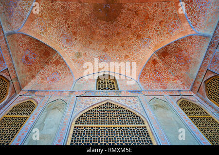 ISFAHAN, IRAN - OCTOBER 21, 2017: The fine floral decoration of semi-dome and wall of portico of Ali Qapu Palace, on October 21 in Isfahan. - Stock Photo