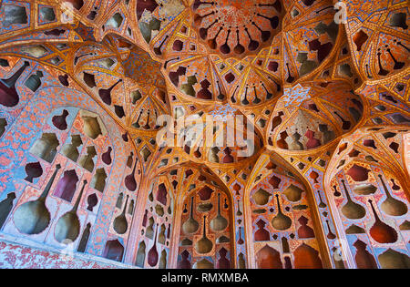 ISFAHAN, IRAN - OCTOBER 21, 2017: The Ali Qapu palace boasts unique Music Hall with numerous different shaped niches in walls and dome for better acou - Stock Photo