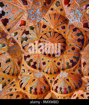 ISFAHAN, IRAN - OCTOBER 21, 2017: The stunning dome of Music Hall of Ali Qapu palace with carved niches, made in Tong Borie technique of plasterwork,  - Stock Photo