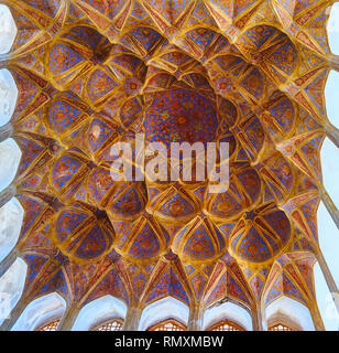 ISFAHAN, IRAN - OCTOBER 21, 2017: The complex carved dome of Music Hall of Ali Qapu palace with honeycomb details, ornate Persian patterns and arched  - Stock Photo