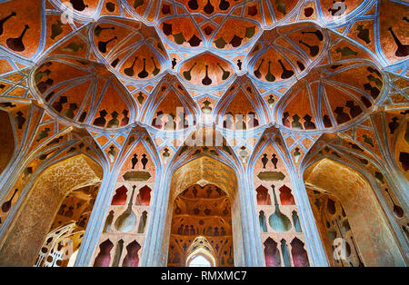 ISFAHAN, IRAN - OCTOBER 21, 2017: The richly decorated Music Hall of Ali Qapu palace with plaster adornaments in authentic Persian Tong Borie techniqu - Stock Photo
