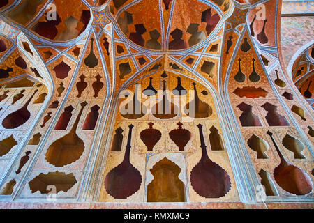 ISFAHAN, IRAN - OCTOBER 21, 2017: Details of unusual wall of Music Hall of Ali Qapu palace, decorated with ornate plasterwork in Tong Borie style and  - Stock Photo