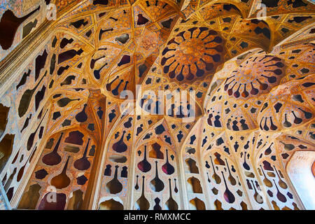 ISFAHAN, IRAN - OCTOBER 21, 2017: The walls and complex dome of Music Hall of Ali Qapu palace are covered with different shaped adornaments in Tong Bo - Stock Photo